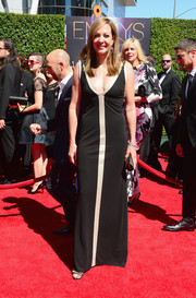 Allison Janney dared to show some cleavage in a low-cut black and silver column dress by Bert Keeter during the Creative Arts Emmy Awards.