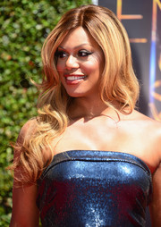Laverne Cox topped off her look with a cascade of waves when she attended the Creative Arts Emmy Awards.