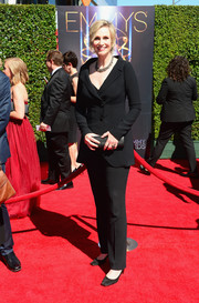 Jane Lynch attended the Creative Arts Emmy Awards wearing a black Chagoury suit.