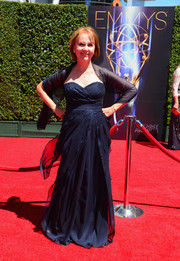 Kate Burton opted for a classic navy strapless gown with a matching wrap for her Creative Arts Emmy Awards look.