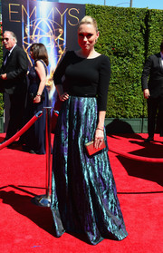 Clare Grant shimmered on the Creative Arts Emmy Awards red carpet in a gown with a flowing, metallic skirt.