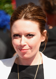 Natasha Lyonne swept her hair back into a slightly messy, center-parted updo for the Creative Arts Emmy Awards.