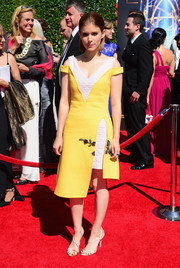 Kate Mara charmed in an asymmetrical yellow and white Dior dress during the Creative Arts Emmy Awards.