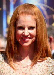 Sarah Rafferty went for a retro feel with this half-up hairstyle at the Creative Arts Emmy Awards.