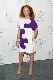 Diane von Furstenberg chose this white and purple puzzle-print dress for the DVF Awards.