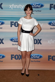 Zooey Deschanel kept it minimal in a short-sleeve white mini dress with black waist detail during the Fox Fall Eco-Casino party.