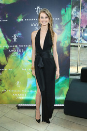Behati Prinsloo oozed sexy glamour in a black halter gown with a deep-V plunge during the Fragrance Foundation Awards.