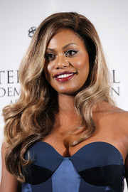 Laverne Cox went to the International Emmy Awards wearing her hair in long, lush waves.