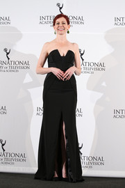 Carrie Preston looked a little daring in a cleavage-baring, high-slit strapless gown at the International Emmy Awards.