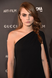 Cara Delevingne styled her locks into a very loose braid for the LACMA Art + Film Gala.