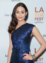 Emmy Rossum complemented her outfit with layers of silver bangles when she attended the screening of 'Comet.'