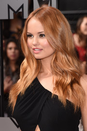 Debby Ryan attended the MTV Movie Awards wearing a sexy center-parted wavy 'do.