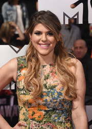 Molly Tarlov oozed femininity with her wavy half-up 'do at the MTV Movie Awards.