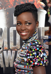 Lupita Nyong'o wore her hair piled on top in tight curls during the MTV Movie Awards.