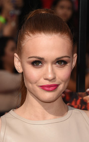 Holland Roden pulled her locks back into a sleek ponytail for the MTV Movie Awards.
