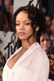 Rihanna was sexily coiffed with this messy, loose updo during the MTV Movie Awards.