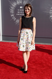 English actress Kathryn Prescott, who stars in the MTV drama Finding Carter, looked demure—if a bit underdressed—in this cropped tank and printed skirt.