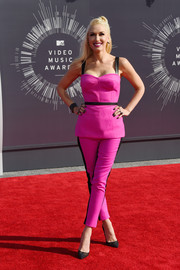 Gwen Stefani was sporty-sexy in her hot-pink L.A.M.B. Couture skinnies and corset top ensemble.