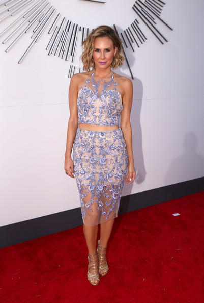 Keltie Knight completed her fierce ensemble with a pair of gold strappy sandals.