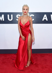 Rita Ora looked sexy in this red silk charmeuse Donna Karan Atelier gown with a thigh-high slit.