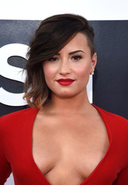 Demi Lovato was punk-glam at the MTV VMAs wearing this half-shaved side-swept wavy style.