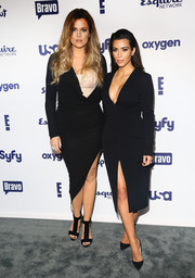 Khloe Kardashian wore a long-sleeve, low-cut LBD over a nude bustier for the NBCUniversal Cable Entertainment Upfronts.