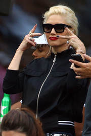 Gwen Stefani watched the US Open sporting edgy black nail polish.