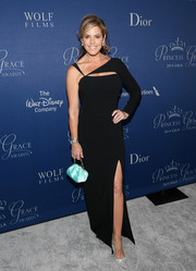 Sandra Taylor went for ultra-modern glamour at the Princess Grace Awards Gala in a black one-sleeve gown with a thigh-high slit and peekaboo detailing.