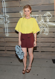 Kate Mara paired her yellow top with maroon peplum shorts, also by Sandro, for a cute color-block look.