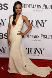Krystal Joy Brown kept it sassy at the Tony Awards in a white halter gown with a plunging neckline, a long train, and fun lip accents.
