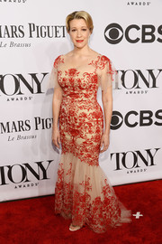 Linda Emond looked regal in an intricately embroidered red and nude mermaid gown at the Tony Awards.
