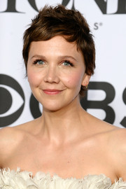 Maggie Gyllenhaal topped off her look with a spiky pixie when she attended the Tony Awards.