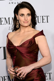 Idina Menzel amped up the luxe factor with a ruby-encrusted clutch by Judith Leiber during the Tony Awards.
