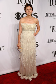 Maggie Gyllenhaal was all about feathers and frills in this cream-colored Dolce & Gabbana strapless gown during the Tony Awards.