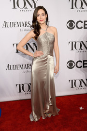 Emmy Rossum shone in a silver halter gown by Ralph Lauren during the Tony Awards.