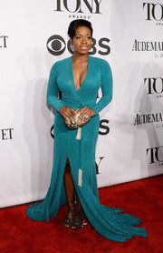 Fantasia Barrino's low-cut blue wrap-style gown at the Tony Awards had a glamorous Old Hollwood feel.