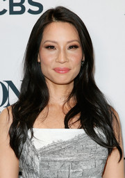 Lucy Liu left wore hair loose with subtle waves and a side part during the Tony Awards nominations ceremony.