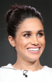 Meghan Markle pulled her locks back into a bun for the 2014 Winter TCA Tour.