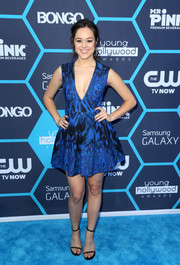 Hayley Orrantia made a sexy statement with this deep-V print dress by AQ/AQ at the Young Hollywood Awards.