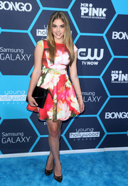McKaley Miller topped off her ensemble with a simple black leather clutch, also by BCBG.