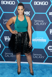 Dascha Polanco went for a flirty look in a teal and black fit-and-flare dress during the Young Hollywood Awards.