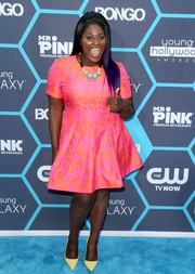 Danielle Brooks teamed her dress with bright yellow pumps for an extra jolt.
