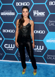 Marie Avgeropoulos rocked a black leather-bodice jumpsuit by Olcay Gulsen at the Young Hollywood Awards.