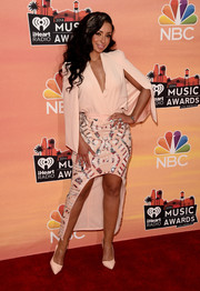 Mya showed a bit of cleavage in her pink Lumier by Bariano cape blazer during the iHeartRadio Music Awards.