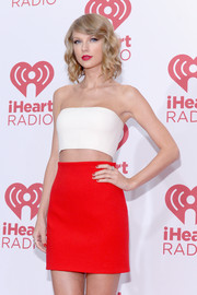 Taylor Swift showed off her midriff in a white bandeau top.