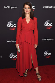 Bellamy Young kept it modest in a long-sleeve red peplum top by Sportmax at the ABC Upfront event.