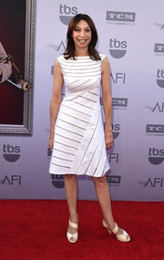 Illeana Douglas looked breezy yet sophisticated at the AFI Life Achievement Award Gala in a little white dress rendered in multidirectional sheer stripes.
