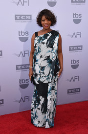 Alfre Woodard attended the AFI Life Achievement Award Gala wearing a flowing floral dress with an asymmetrical neckline.