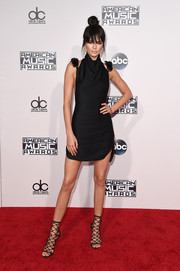 Kendall Jenner vamped it up in a little black halter dress by Oriett Domenech at the American Music Awards.