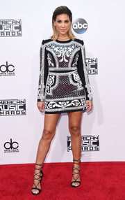 Liz Hernandez flaunted plenty of leg in a beaded mini dress by Balmain at the American Music Awards.